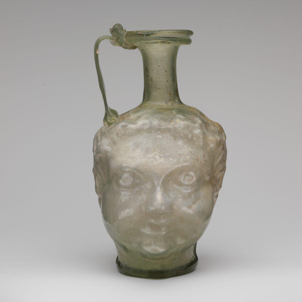 Glass double head-shaped jug