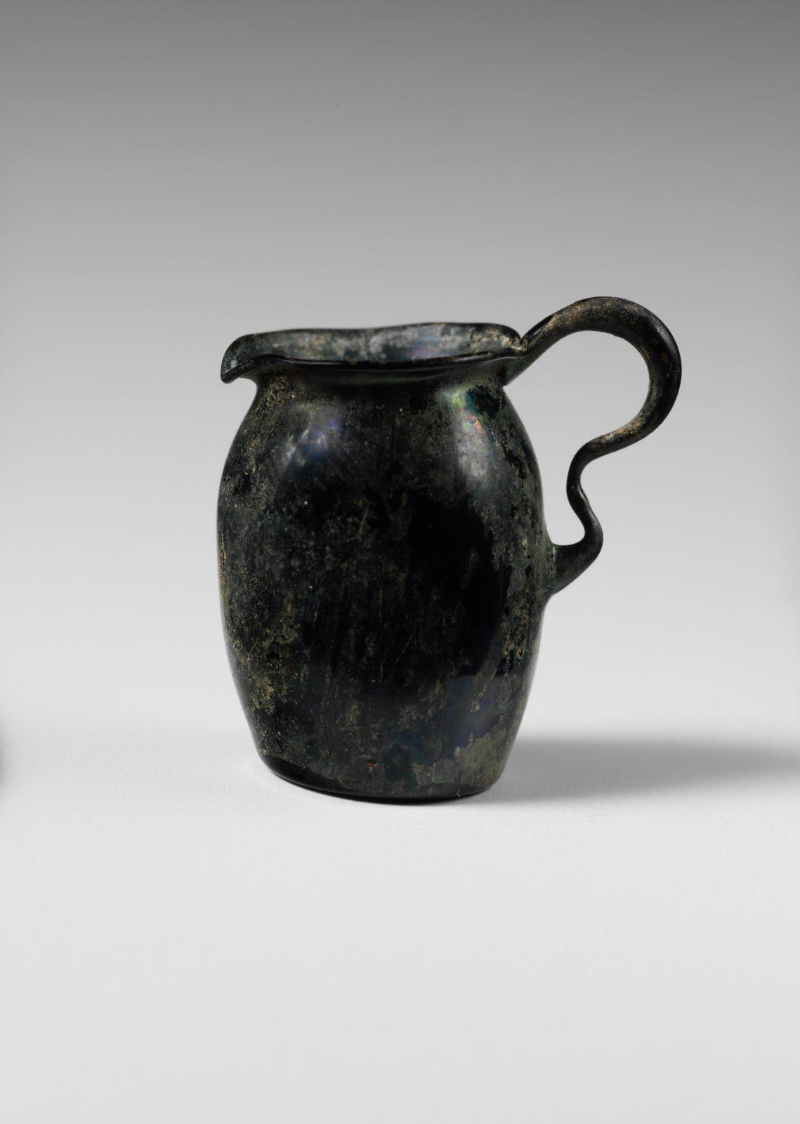 Glass miniature one-handled jug