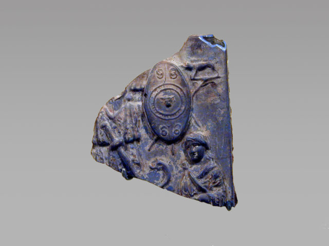 Glass plaque fragment depicting a trophy and captives