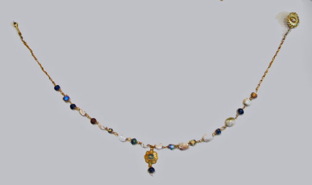 Gold, pearl, and glass necklace