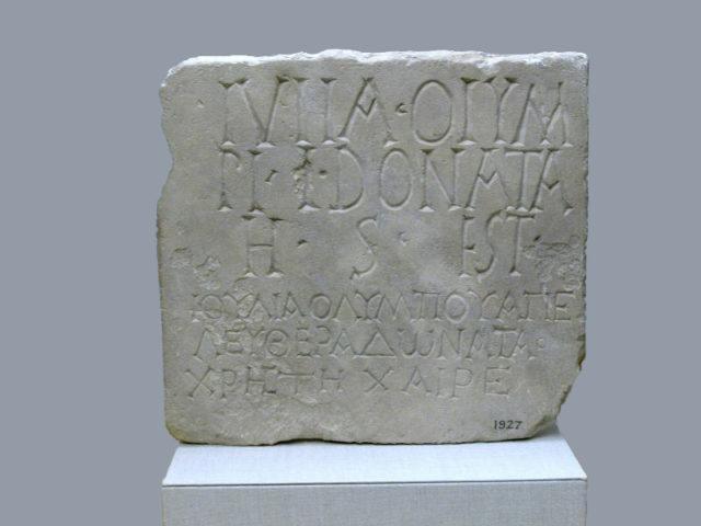 Limestone plaque with bilingual inscription