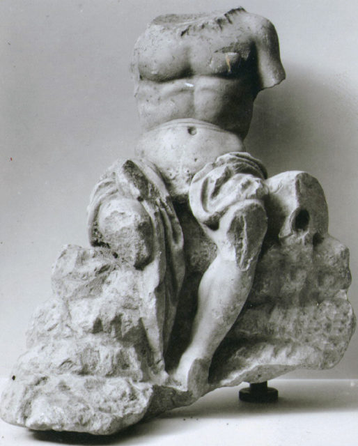 Marble statuette of a seated man