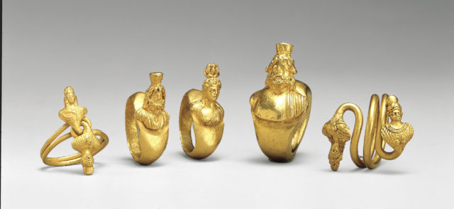 Ring with terminal busts of Ptah (?) and a female consort twisted for a bezel