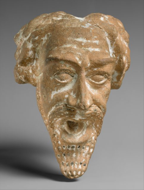 Spout in the form of a man's head