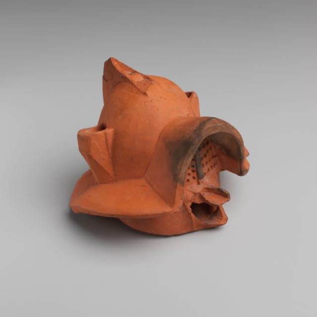 Terracotta lamp in the form of a gladiator's helmet