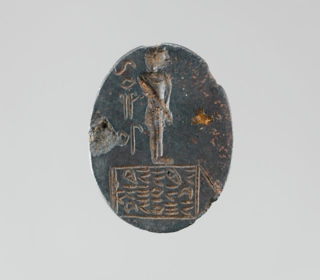 Haematite intaglio: Youth on inscribed stele