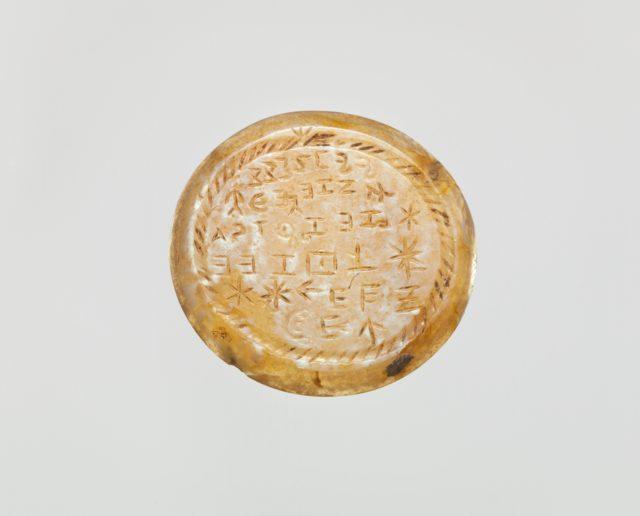 Onyx intaglio: Incantation in Greek letters