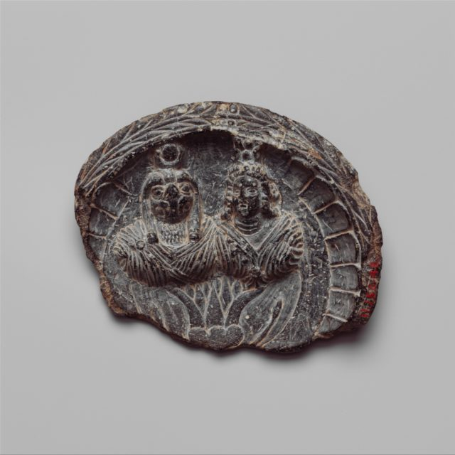 Shallow dish with high relief figures of Isis and falcon-headed Horus