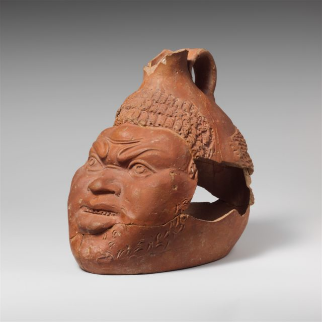 Terracotta jug in the shape of a head of an African