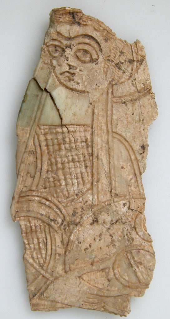 Fragment of a Plaque with a Standing Woman