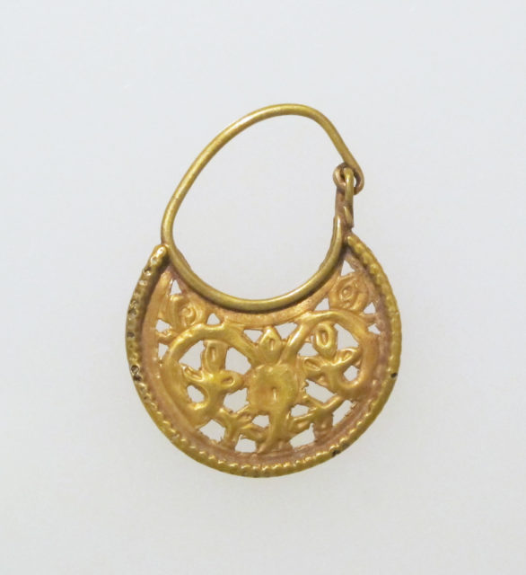 Gold lunate earring with scrolls