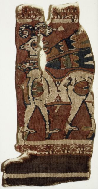 Textile fragment: walking ram with a neckband and fluttering ribbons