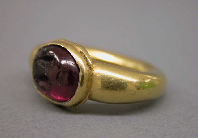 Ring with Dark Red Inset Oval-Shaped Stone