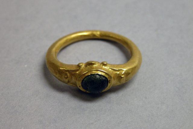 Ring with Green Stone in Circular Setting