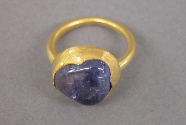 Ring with Inset Blue Stone in Circular Mount