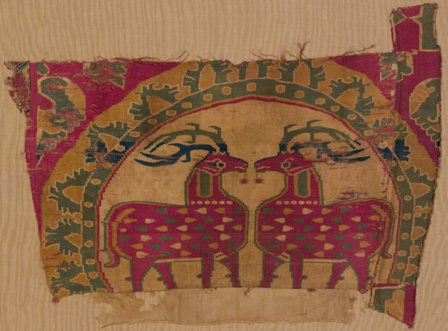 Textile Fragment with Confronted Deer in Partial Pearl Roundel with Serrated Outer Border