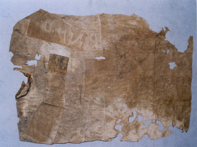 Woman's tunic with silk decoration at collar and one cuff