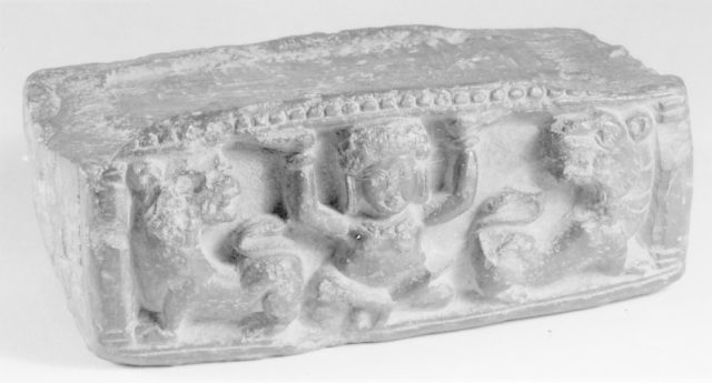 Pedestal with Yaksha and Two Lions