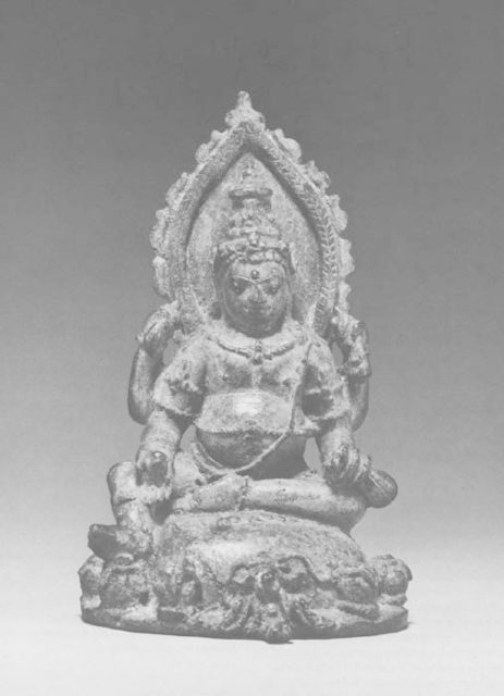 Seated Four Armed Jambhala, the Buddhist God of Wealth