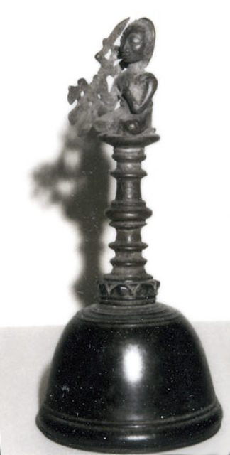 Bell with Seated Male Holding Vajra