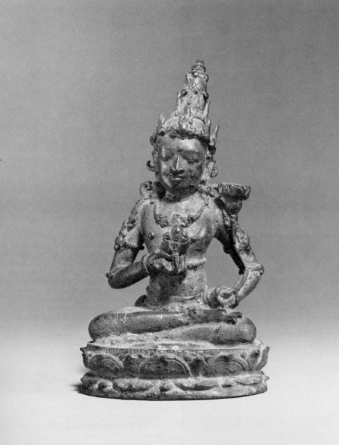 Seated Deity Holding a Double Vajra