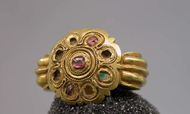 Stirrup-Shaped Ring with Stones Set in Circular Bezel