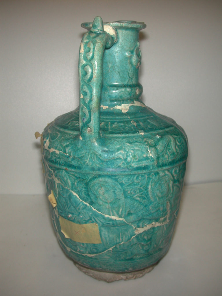 Ewer with Molded Inscriptions, Animals and Dancers