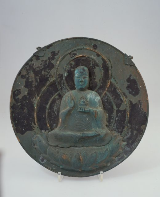 Shinto/Buddhist Votive Plaque with Image of Jizo (Ksitigarbha Bodhisattva) Attached to a Circular Mirror