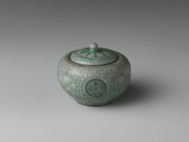 Small jar and cover decorated with chrysanthemums, cranes, and clouds