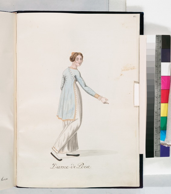 Dame de Pera. Woman in long white dress and shorter pale blue coat with gold trims, wearing pearls over one shoulder; shown in three-quarter back view. [80]