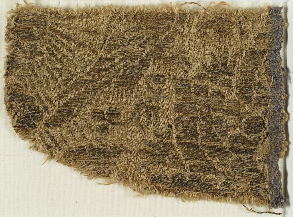 Textile with Eagle, Rayed Sun, and Flowers
