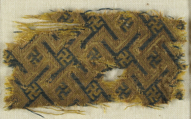 Textile with Interlacing Bands forming Swastika Figures