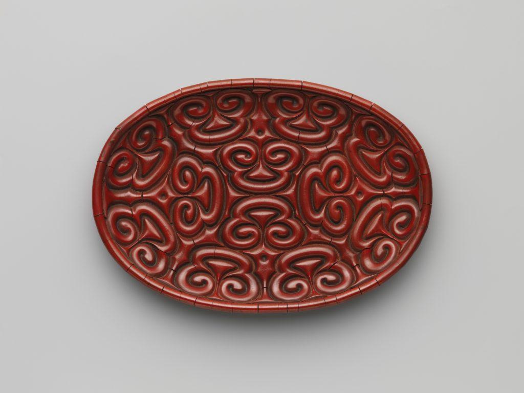 Tray with pommel scrolls