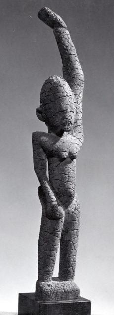 Female Figure with Raised Arm