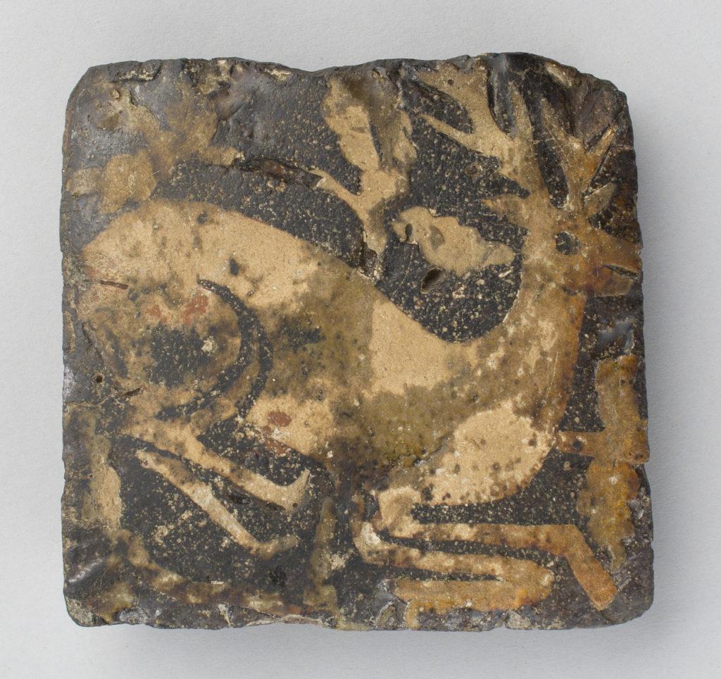 Tile with kneeling hart