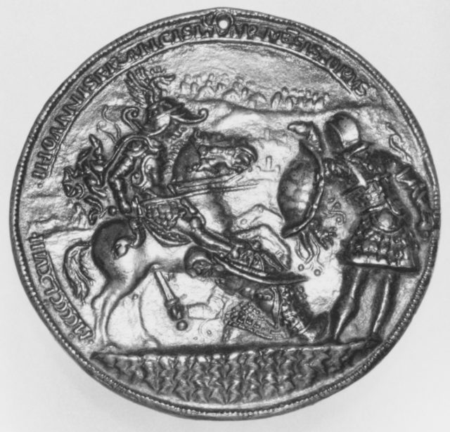 A horseman fighting two foot soldiers