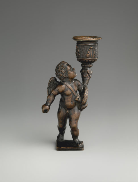 Cupid holding a candle socket