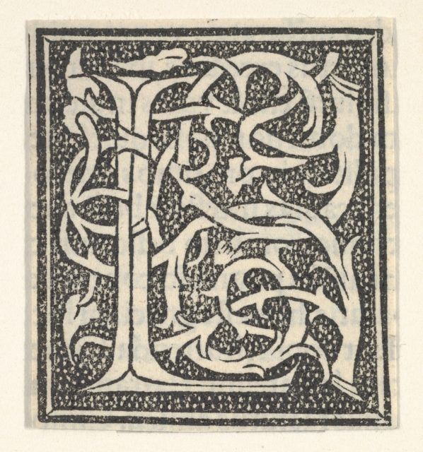 Initial letter L on patterned background