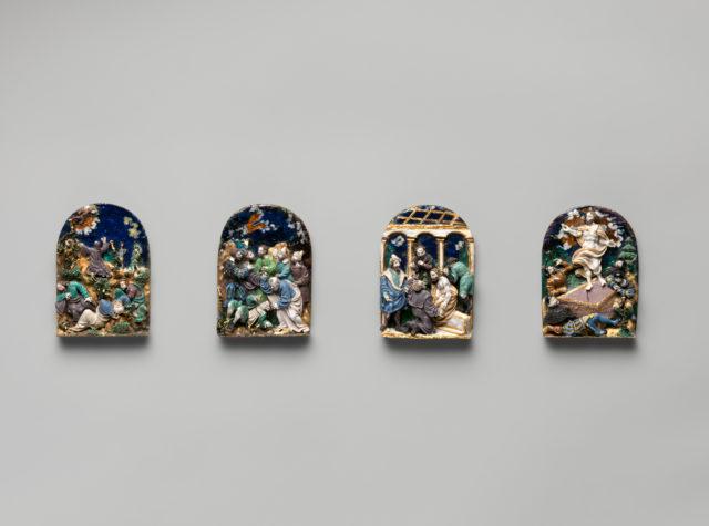 Set of four enamelled silver plaquettes