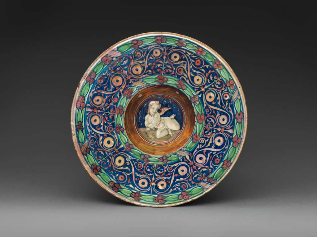 Wide-rimmed bowl with winged putto