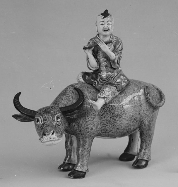 Boy Riding Buffalo