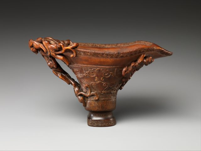 Cup in the shape of an archaic vessel with feline dragons