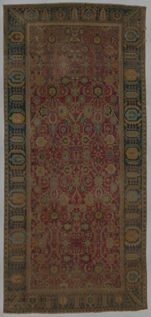 Indo-Persian carpet with repeat pattern of vine scrolls and palmettes