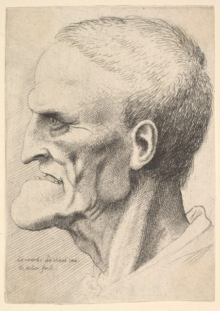 Head of an old man with a pronounced chin, short cropped hair and gaping mouth showing teeth in profile to left