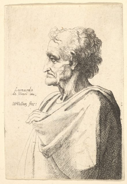 Man with doleful expression to left with hand emerging from cloak