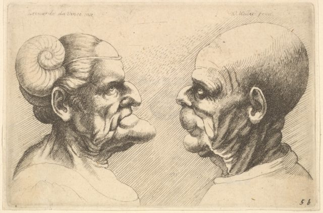 Two deformed heads facing each other