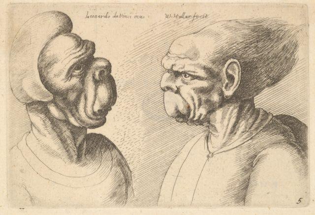 Two deformed heads facing inwards