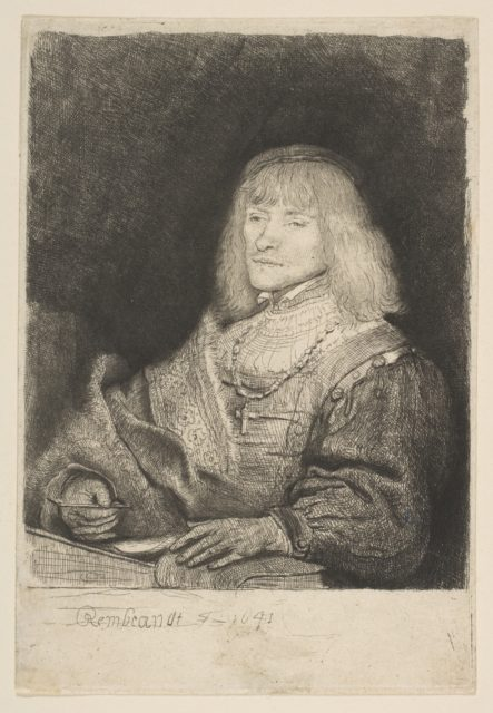 Man at Desk, Wearing Cross and Chain
