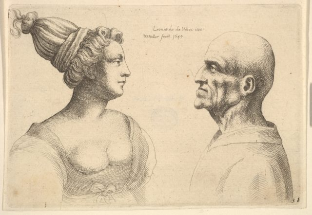 A female with hair tied back and a bald male facing each other