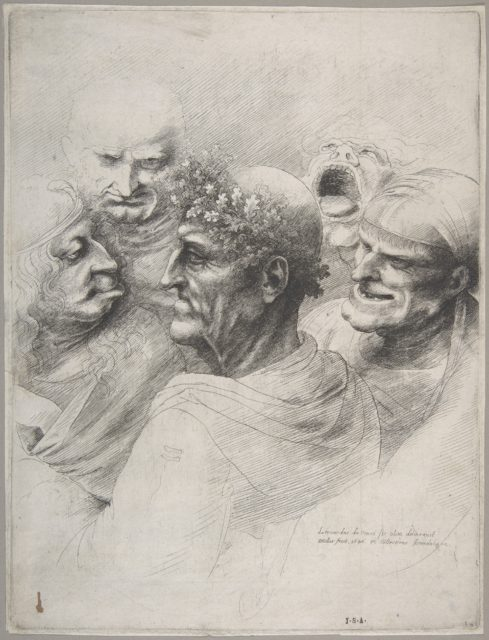 Five grotesque heads, including an elderly man with an oak leaf wreath